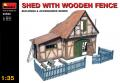 7000 shed with wooden fence