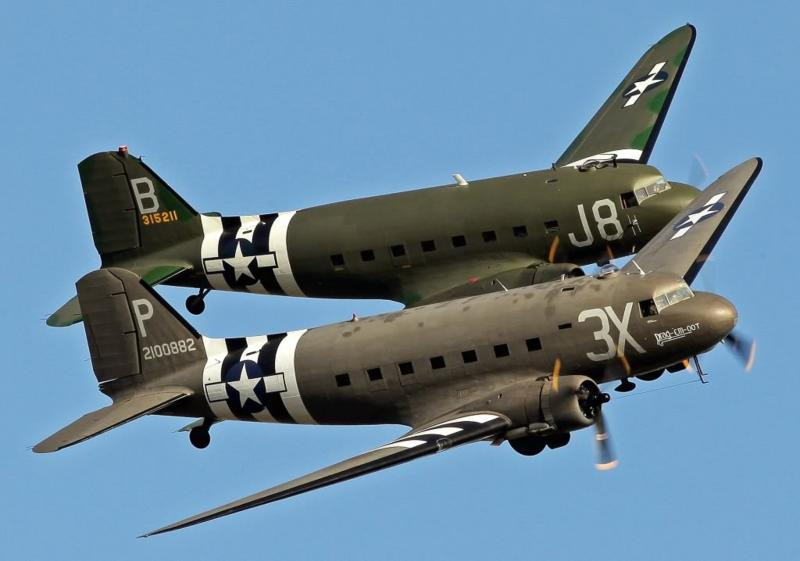 Project-Two-restored-Douglas-DC-3-C-47-Dakota-Skytrains-in-formation-during-an-airshow